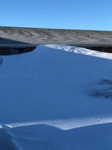 Snow drift to the roof of building
