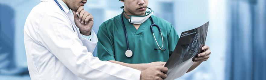 Doctors analyzing x-ray