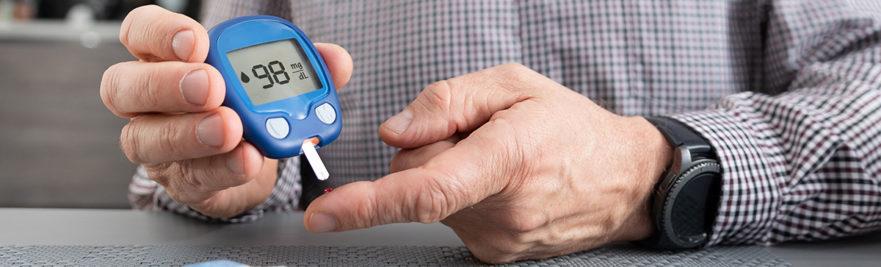 Man testing blood sugar