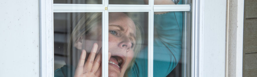 Woman at Window with Cabin Fever