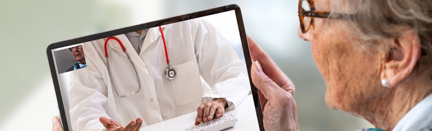 Senior woman consults a e-health doctor with tablet