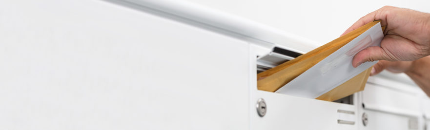 putting mail in mailbox slot