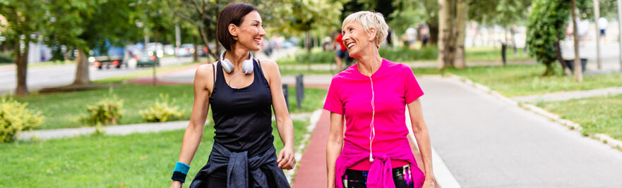 2 women walking for fitness